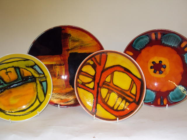 A collection of four Poole Pottery plates