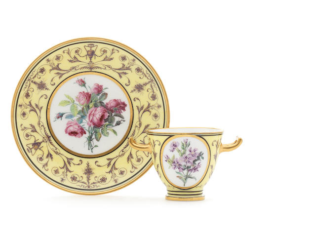A Sèvres yellow-ground two-handled cup and saucer, circa 1793-1800