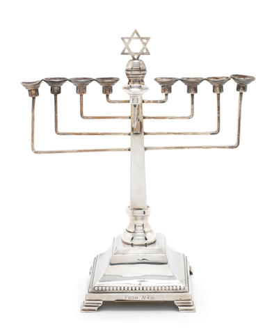 A silver musical Hanukkah candelabrum, by A. Taite & Sons, London, 1957,