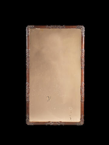 A large wood-mounted, pink-tinted mirror 19th or 20th century