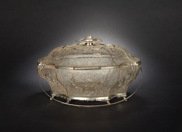 A white metal, filigree basket and cover