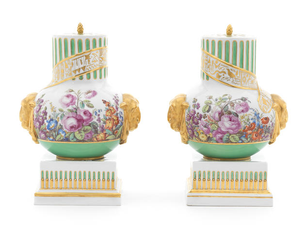 A pair of Berlin green-ground pot-pourri vases and covers on plinths, circa 1803-13