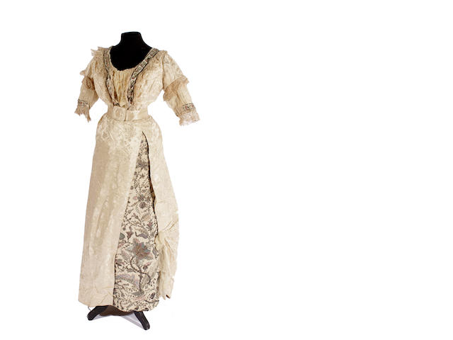 A circa 1900 cream damask silk evening dress