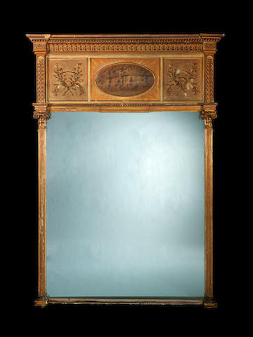 A large late George III carved giltwood and white painted overmantel mirror