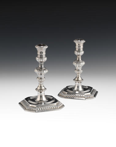 A pair of William & Mary cast silver candlesticks, London 1691