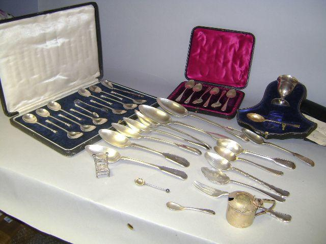 Mixed silver lot: cased egg cup & spoon, mustard pot, two cased sets of spoons (1 odd spoon), miniature model of a chair and items of flatware