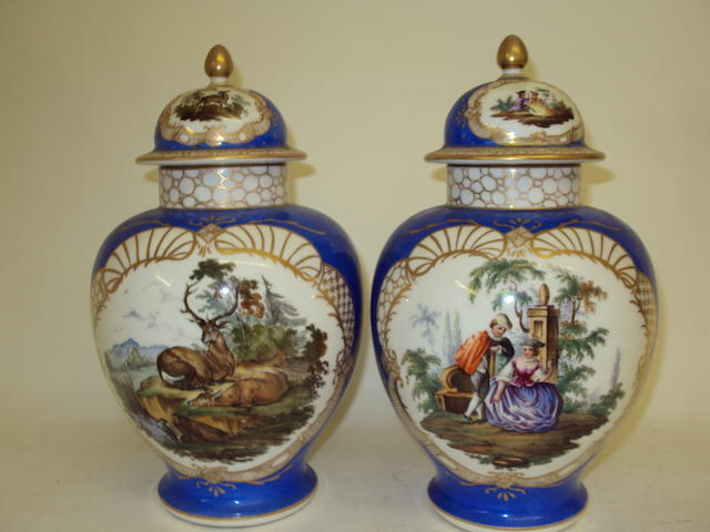 A pair of Augustus Rex-style baluster vases and covers