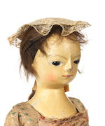 An important George II wooden doll, English circa 1750