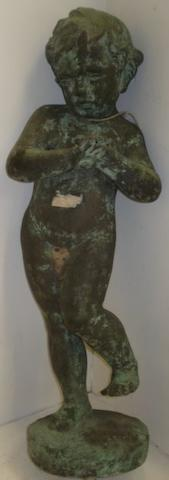 A patinated copper clad figure, of a young child hand clasped and standing on one foot, 66cm.