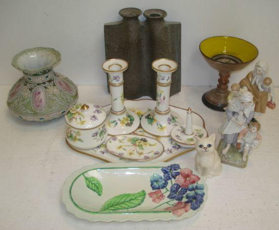 A Crown Staffordshire porcelain dressing table set, painted with flowers by W Hartshorne, six pieces, pair of Berlin figure groups of mother and children, early 20th Century filigree decorated compressed lobed vase, Royal Doulton figure of a cat, Carlton ware dish and other items.