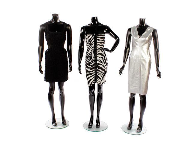 Seven various designer dresses