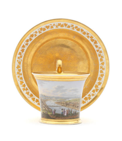 A Vienna chocolate cup with saucer decorated with a view of Budapest