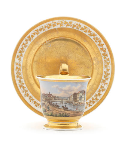 A Vienna cup and saucer decorated with a view of the Ferdinand Bridge, dated 1831