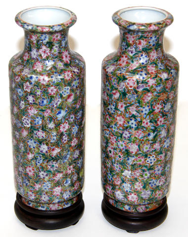 A pair of Chinese famille rose millefleur vases