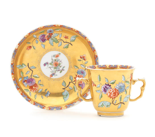 A rare Meissen gold-ground two-handled beaker and saucer, circa 1735