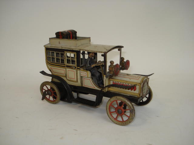 Gunthermann Georgian window Limousine with key wind to rear wheel, circa 1910 See Toy Autos 1890-1939 The Peter Ottenheimer Collection, pg.62.