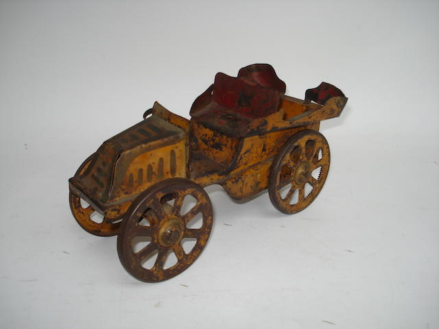 Early tinplate rear-entrance Tonneau type toy car, possibly American circa 1900