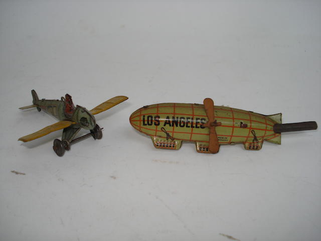 Penny toy whistle Airship and Distler MonoPlane 2