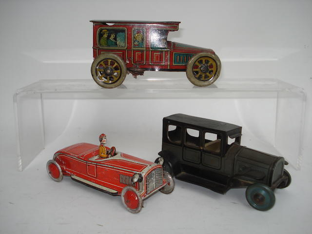 Two tinplate c/w Limousines and an open tourer 3