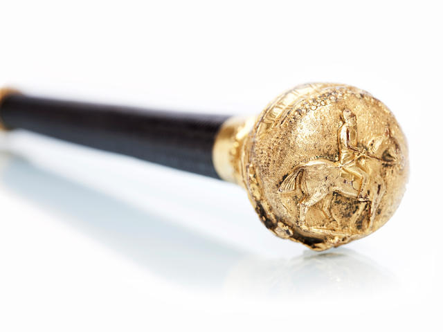 A riding crop with gilt metal ornamental handle apparently unmarked
