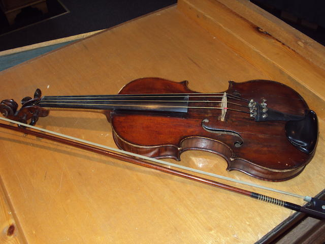 A cased student violin and bow