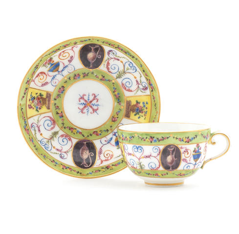 A Sèvres teacup and saucer, circa 1792, grotesques