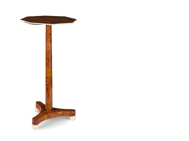A rare Regency tortoiseshell veneered occasional table