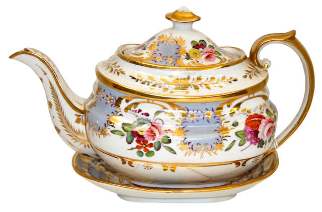 A Coalport twelve place tea and coffee servicecirca 1830, painted with floral sprays, panels of milky blue and extensively gilt, to include a teapot on stand, sucrier and cover, cream jug, slop basin and two sandwich plates, lacking two coffee cups and three teacups
