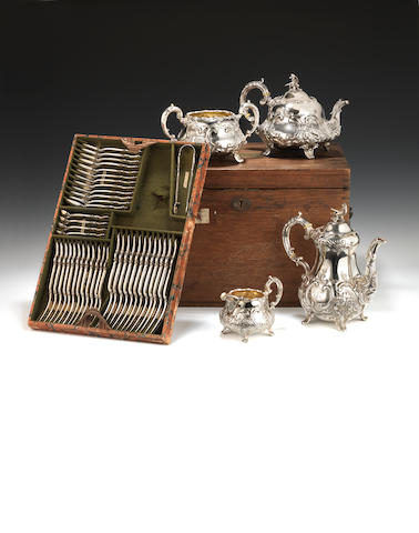 A Victorian oak cased silver four piece tea and coffee service and flatware the holloware by William Smily, London 1858  (70)