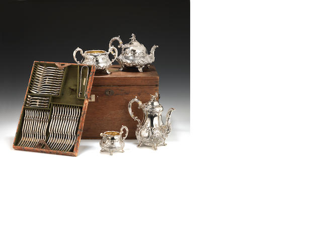A 19th Century four piece Silver tea service together with  a 12 place Silver cutlery setting. (total approx 195oz) All contained in a Silver Box