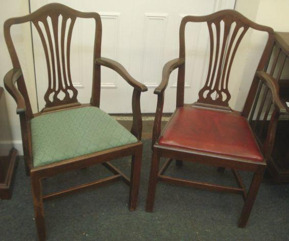 A pair of 20th Century mahogany open elbow chairs, in the Hepplewhite taste, drop-in seats on moulded square legs.