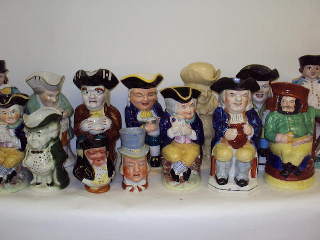 A collection of various Staffordshire Toby jugs, mainly 20th century