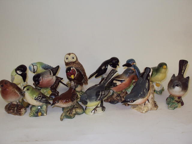 A collection of fifteen small Beswick birds