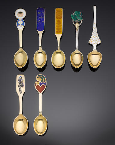 A Danish silver, silver-gilt and enamelled commemorative'sugar beet' spoon by A Michelsen, Copenhagen, also marked STERLING together six other silver-gilt and enamelled commemorative year spoons, by A Michelsen, 1964 to 1969, each with varying enamelled terminals (7)