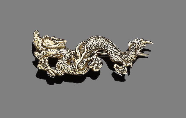 A late 19th/early 20th century Chinese export  yellow metal dragon brooch impressed 'WH90' three times to reverse