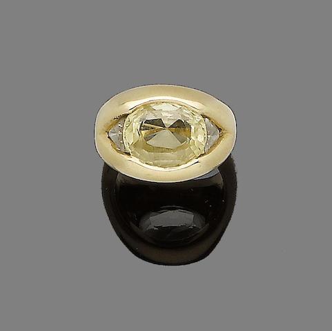 A yellow sapphire and diamond ring, by Bulgari