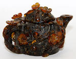 A Chinese amber miniature teapot and cover,