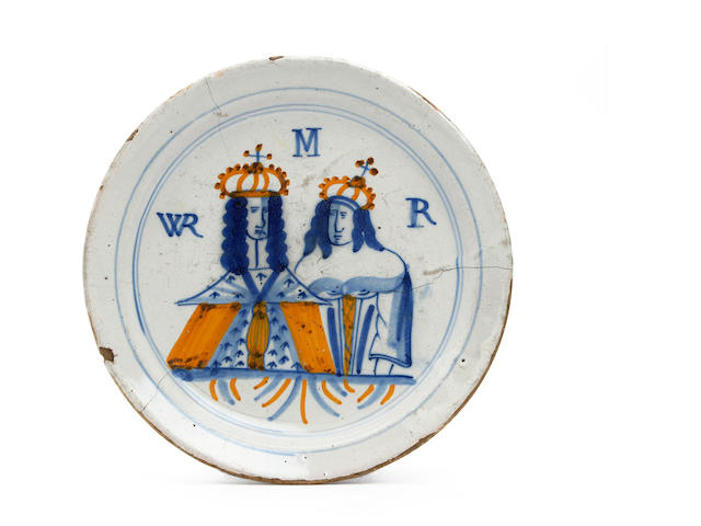 A London delft royal portrait plate Circa 1690