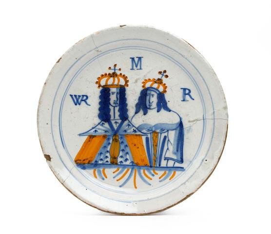 A London delft royal portrait plate Circa 1690