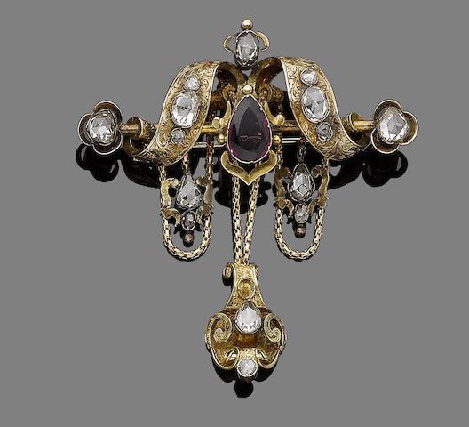 A garnet and diamond festoon brooch,