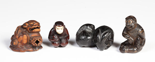 Four wood animals; monkey signed Ryukei, Shishi signed Minkoku, two rabbits and a seated monkey/4