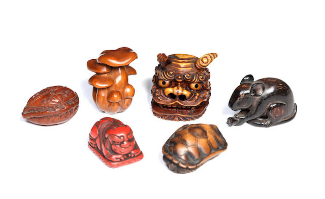 Six various netsuke; wood turtle, lacquered shishi, seated rat, shishi mask, mushrooms and carved nuts/6