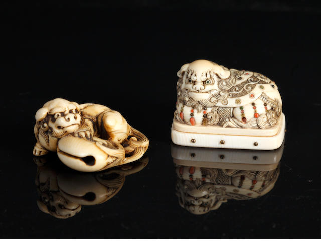 Two ivory netsuke of shishi; one with added base, both unsigned, 19th century/2