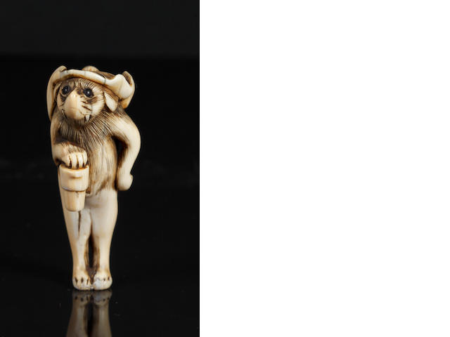 Ivory badger in human form, probably broken and restored, unsigned, early 19th century