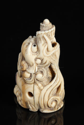 Ivory seated baku, unsigned, early 19th century (chipped and re-carved) style of Mitsuharu