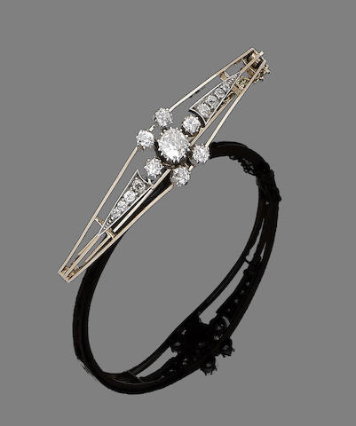 A diamond hinged bangle,