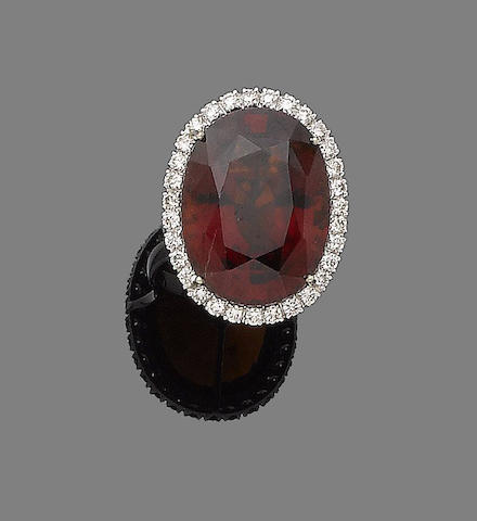 A garnet and diamond ring