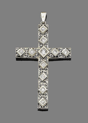 A diamond cross pendant,