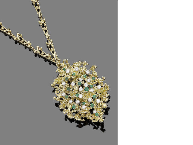 An emerald and diamond brooch/pendant/necklace