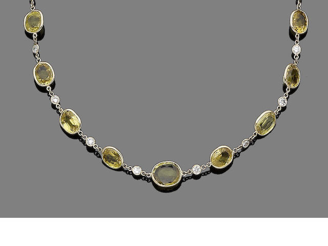 A yellow sapphire and diamond necklace